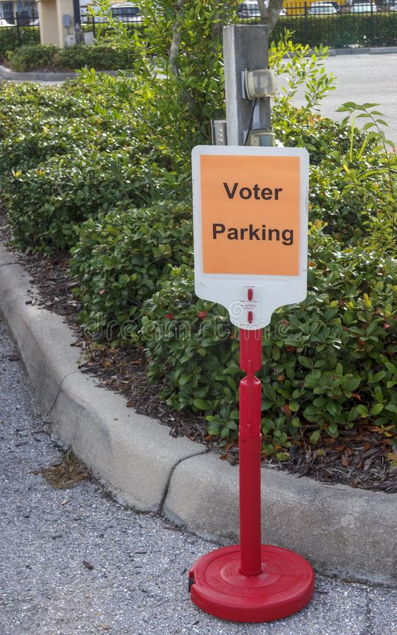 Parking space designated for voter. Voting information sign at public polling place royalty free stock images
