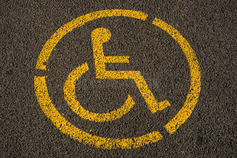 Parking space sign - reserved for person with disability stock photos