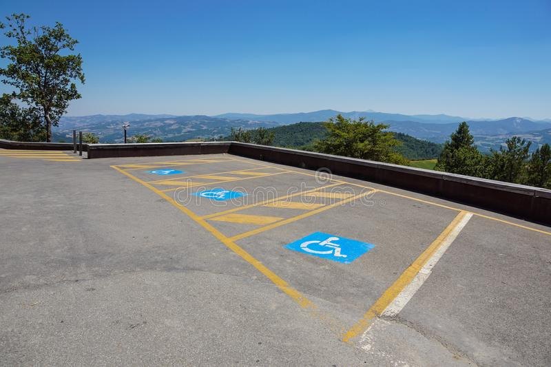Parking spaces reserved for the disabled in outdoor lot for the public stock photo