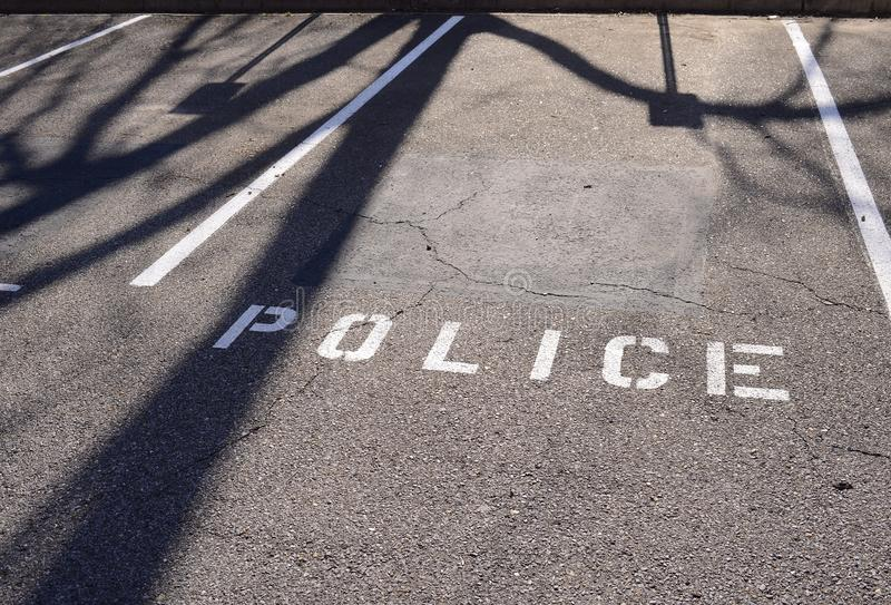 Police Force Law Enforcement. A parking spot that has been designated as police force law enforcement parking only stock photography