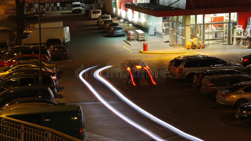 Parking at the supermarket at night royalty free stock photography