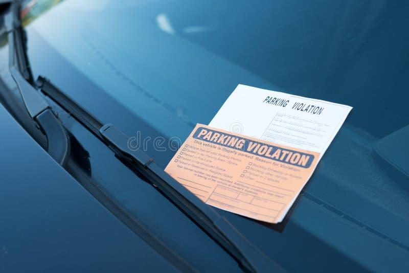 Parking violation ticket fine on windshield royalty free stock photo