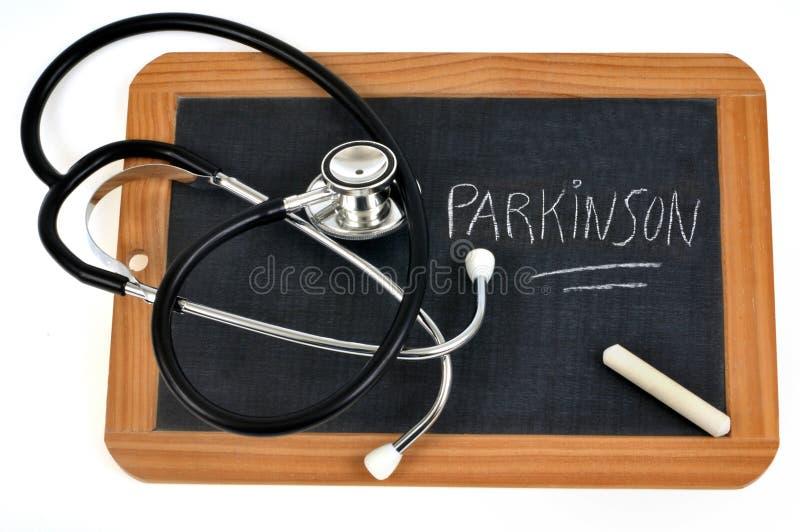 Parkinson que escreve em uma ardósia da escola imagens de stock royalty free