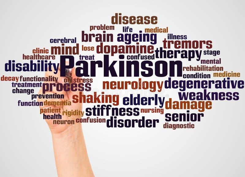 Parkinson słowa ręka z markiera pojęciem i chmura zdjęcia royalty free