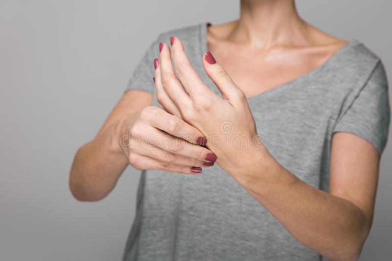 Parkinson`s disease symptoms. Close up of tremor shaking hands of Middle-aged women patient with Parkinson`s disease. Parkinson`s disease symptoms. Close up of royalty free stock images
