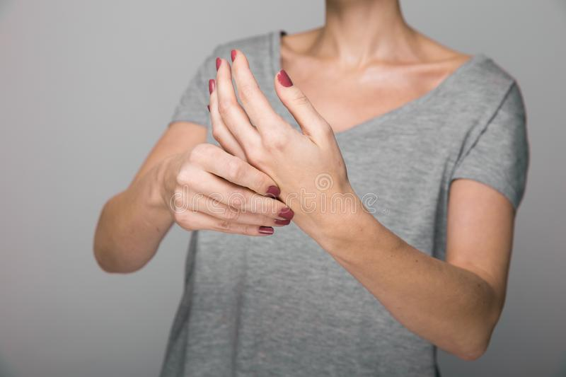 Parkinson`s disease symptoms. Close up of tremor shaking hands of Middle-aged women patient with Parkinson`s disease. Parkinson`s disease symptoms. Close up of royalty free stock photos