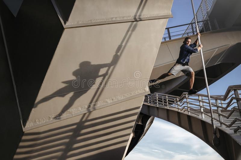 Parkour athlete flies over the abyss. Dangerous freerunning exercise royalty free stock image