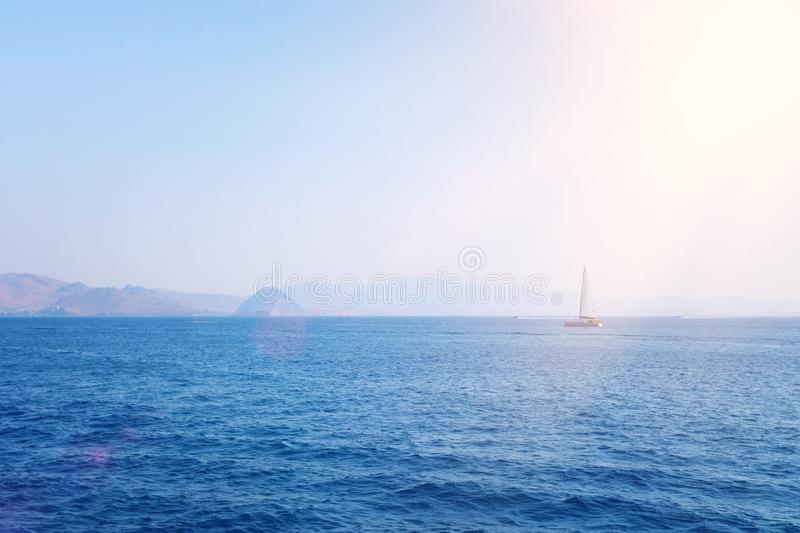 Parks/Outdoor image of Sailboat in the beautiful Mediterranean sea at the sunlight.  stock photography