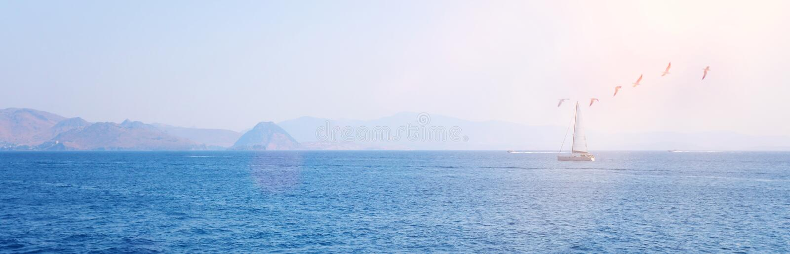Parks/Outdoor image of Sailboat in the beautiful Mediterranean sea at the sunlight. banner.  stock photo