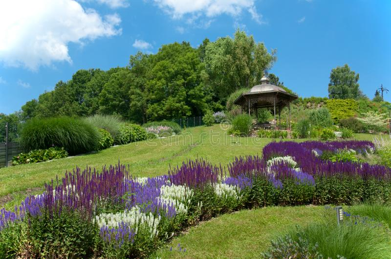 Parkway with many different flowerbeds and pavillon on a sunny summer day - Austria. Beautiful parkway with many different flowerbeds and pavillon on a sunny royalty free stock photo