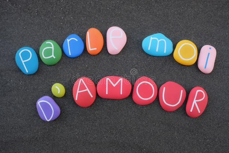 Parle moi d`amour, talk to me about love, artistic phrase. Parle moi d`amour, Talk to me about love, french classic sentence composed with multicolored stones stock photos