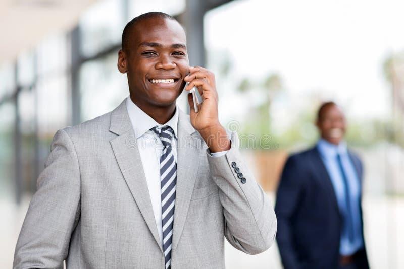 Parler d'entreprise africain de travailleur photos stock