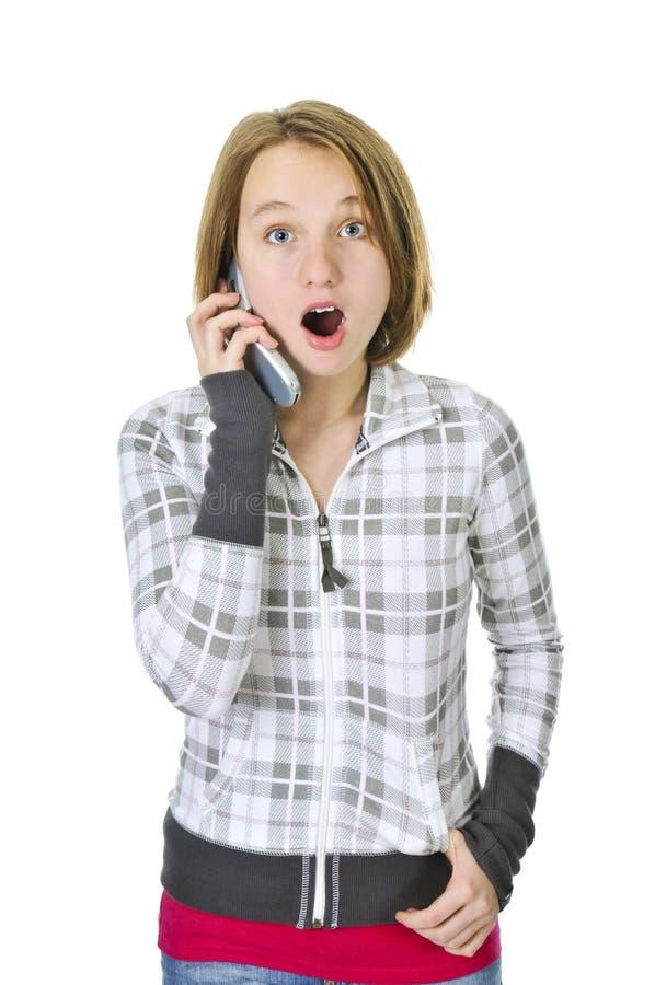 parler de téléphone de fille d'adolescent photo libre de droits