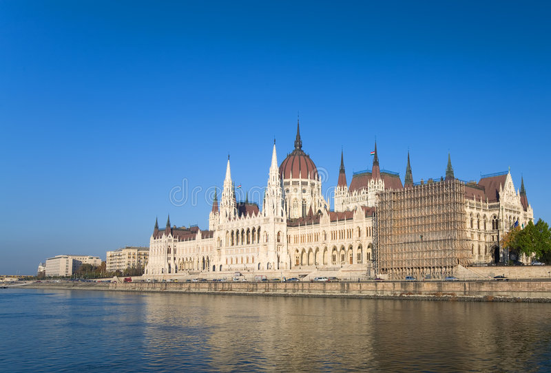 Parliament in Budapest. Budapest parliament over blue sky with river Danube stock image
