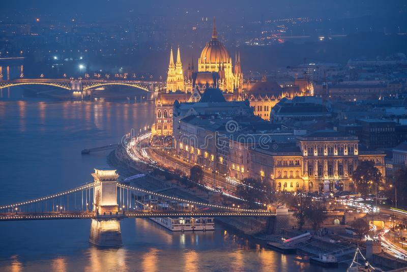 Parliament Building and Bridges over the Danube River at Night, Budapest, Hungary. Illuminated Parliament Building and bridges over the Danube River at night royalty free stock photos