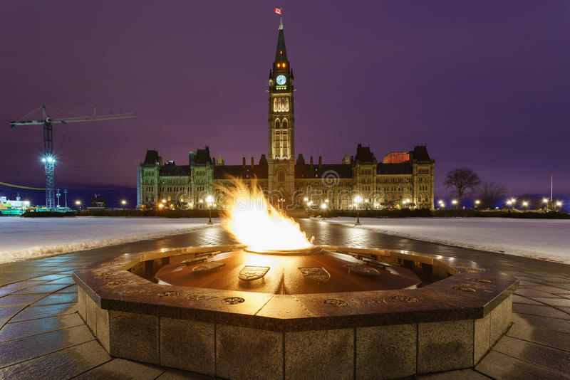 Parliament Hill and the Centennial Flame in Ottawa, Canada stock photo
