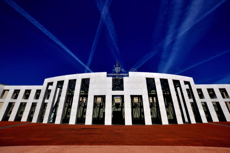 Parliament House Canberra Australia front view. And jet streams in sky stock photos