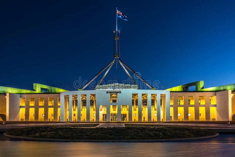 Parliament House illuminated at night, Canberra, Australia. Front façade of the Parliament House illuminated at night in the national capital Canberra royalty free stock image