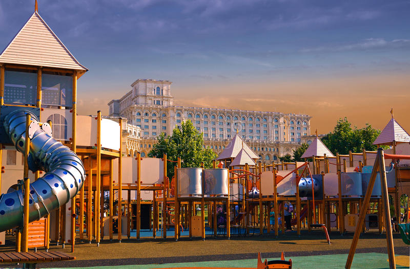 Parliament House part of the play ground. Beautiful House of the Romanian Parliament spotted from the Izvor Park Bucharest seems like is part of the play ground stock photo