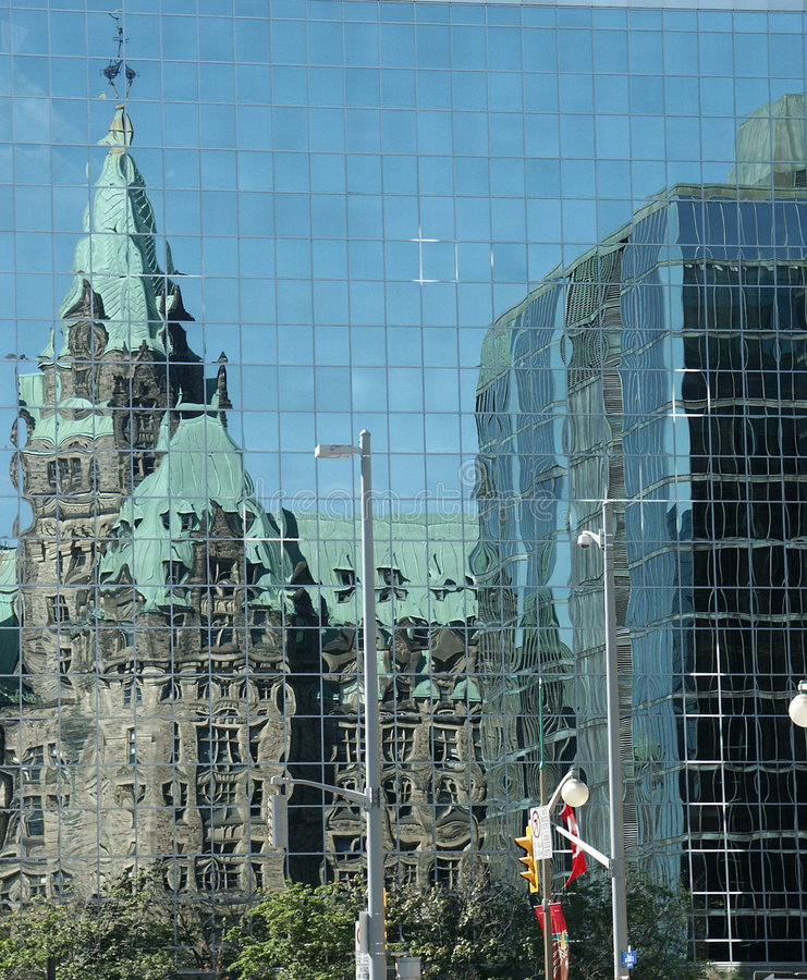 Parliament Reflections. Shot of Canadian Parliament bulidings reflected in the windows of another building royalty free stock photos