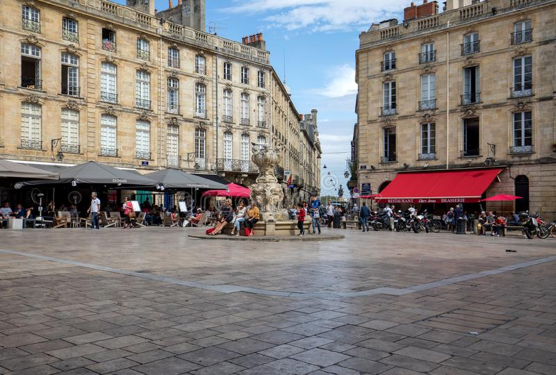 Parliament Square or Place du Parlement . Historic square featuring an ornate fountain, cafes and restaurants in Bordeaux, France. Bordeaux, France - September 9 royalty free stock photography