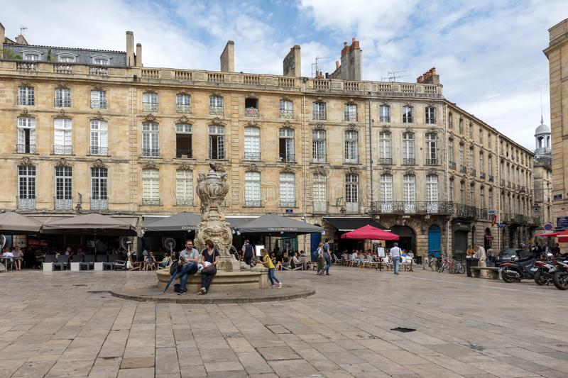 Parliament Square or Place du Parlement . Historic square featuring an ornate fountain, cafes and restaurants in Bordeaux, France. Bordeaux, France - September 9 royalty free stock photo
