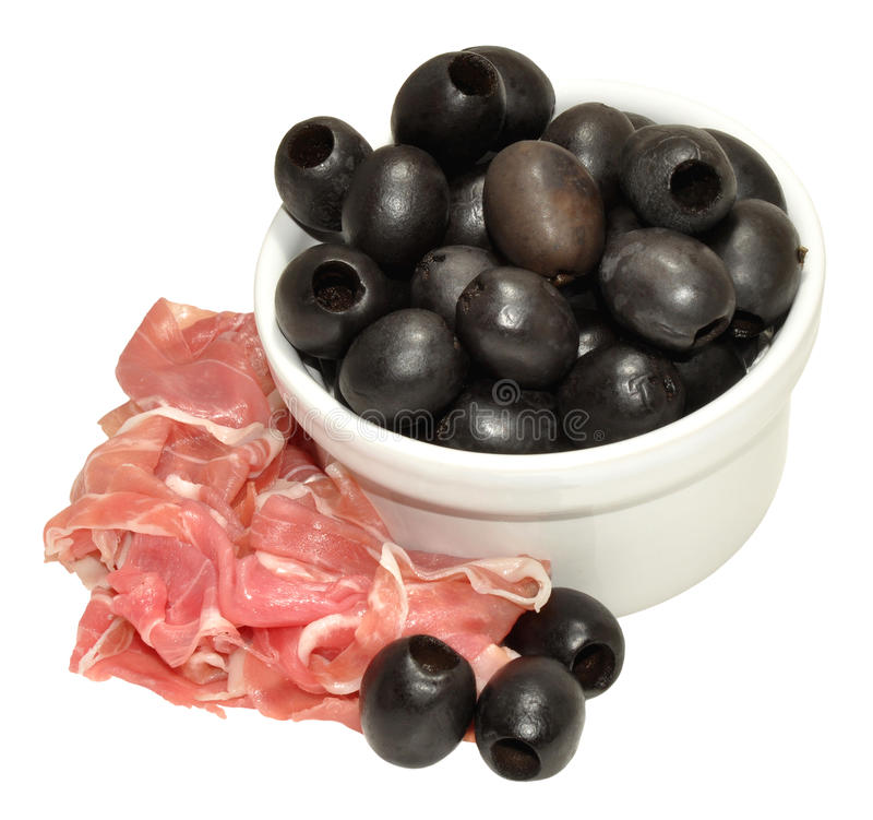 Parma Ham And Black Olives. Dry cured Parma ham and pitted black olives, isolated on a white background stock images
