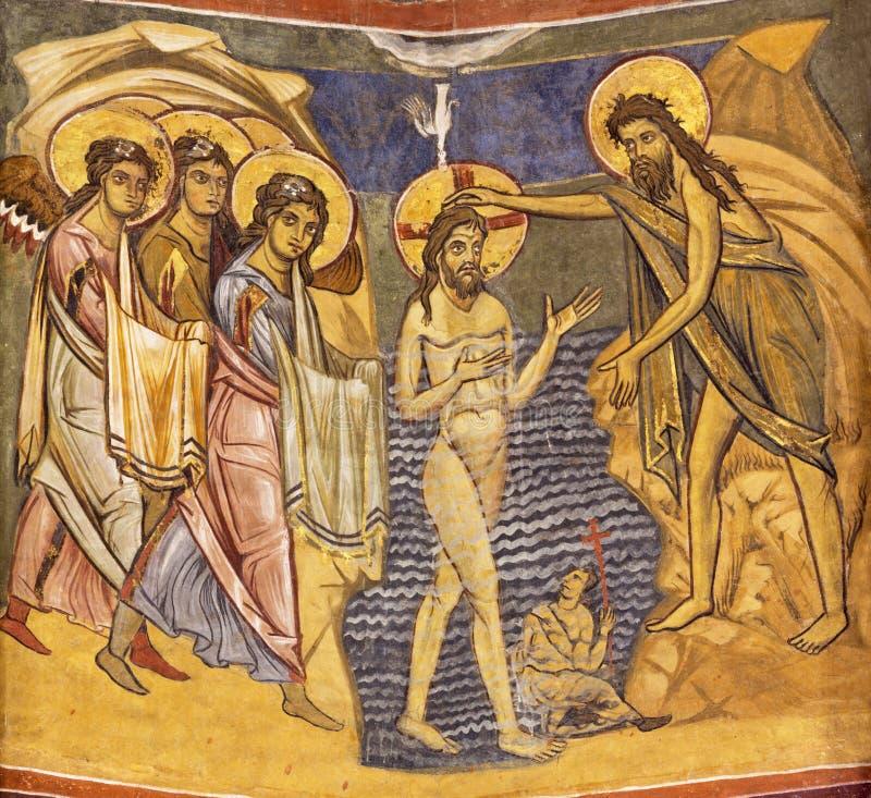 PARMA, ITÁLIA - 16 DE ABRIL DE 2018: O batismo do fresco de Jesus no estilo icônico bizantino no Baptistery foto de stock royalty free