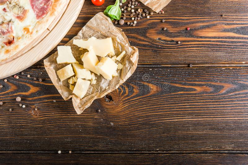 Parmesan cheese on a dark wooden background. Pizza Ingredients. Background. Parmesan cheese on a dark wooden background. Pizza Ingredients royalty free stock photo