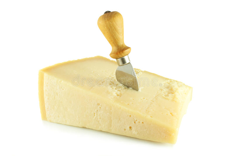 Parmesan cheese and a knife royalty free stock images