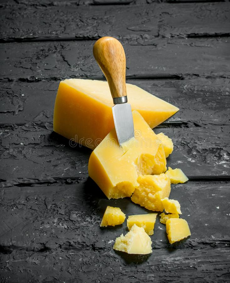 Parmesan cheese with knife stock photography