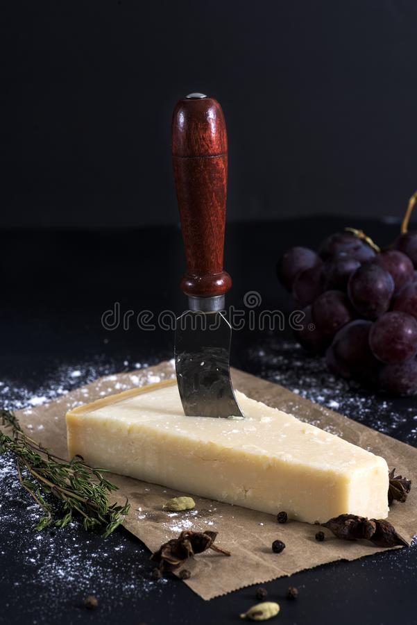 Parmesan cheese with knife stock images