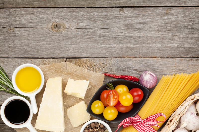 Parmesan cheese, pasta, tomatoes, vinegar, olive oil, herbs and stock photography