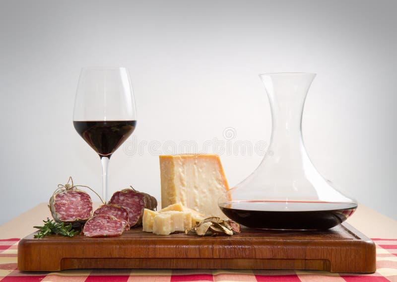 Parmesan cheese salami and wine. Bread parmesan cheese salami and red wine stock images