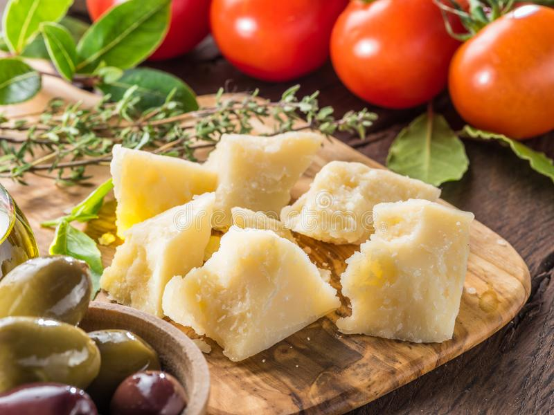 Parmesan cheese on wooden cutting board. Food background.  stock photos