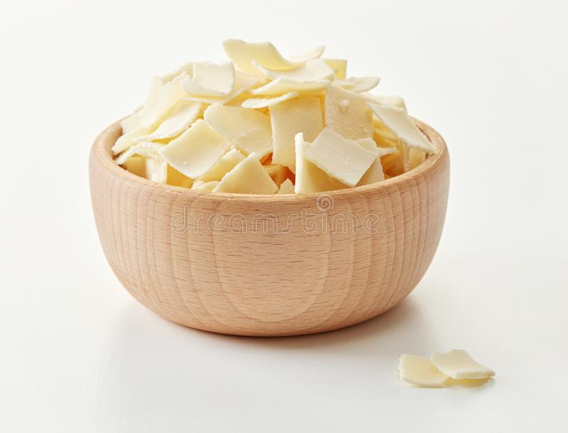 Parmesan flakes in a bowl stock image