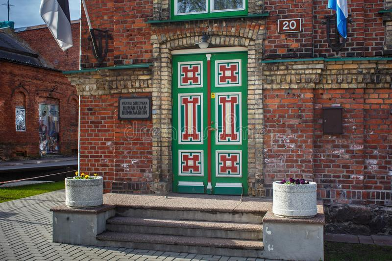 PARNU, ESTONIA - MAY 02, 2015: Wooden doors of the old humanitarian school Sutevaka in historical center of Parnu on the Louna. Street royalty free stock images