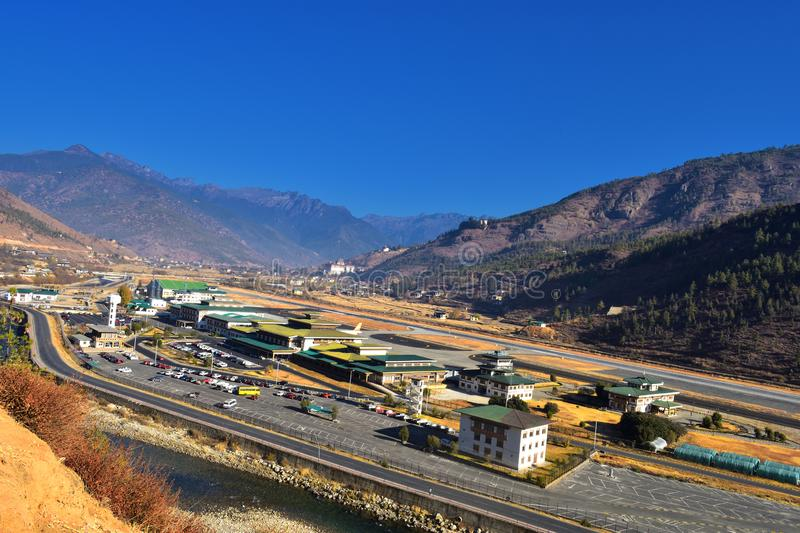 Paro Airport in the Mountains - Bhutan. mountain landscape with village and mini airport royalty free stock image