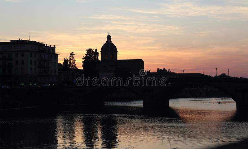 The Parochia San Frediano in Cestello in Florence, Italy. At sunset, and the Arno river stock photos