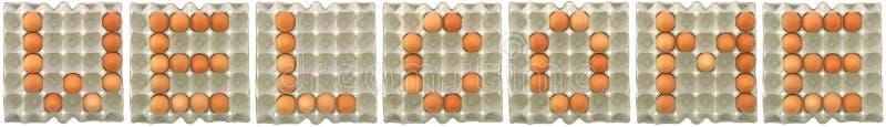 Parola BENVENUTA dalle uova in vassoio immagine stock