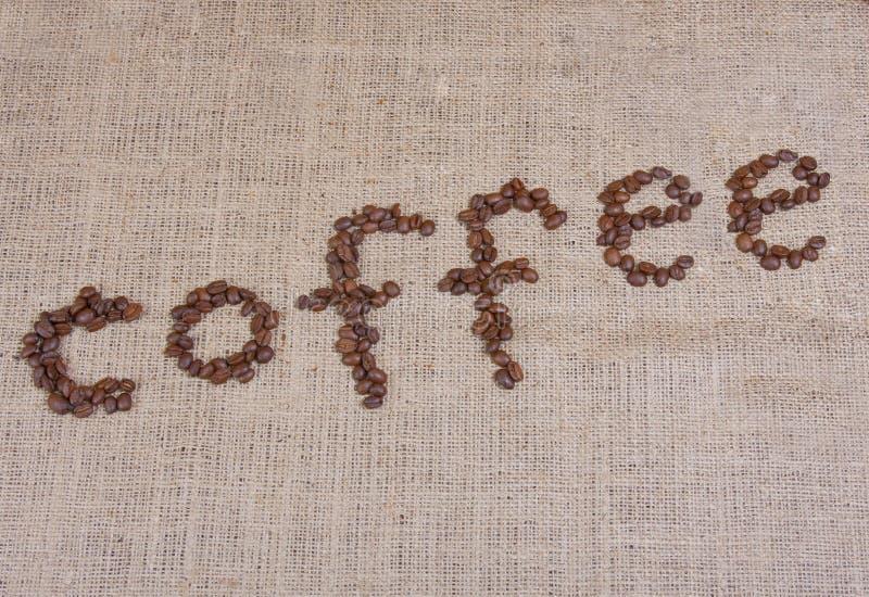 Parola del caffè con i fagioli fotografie stock