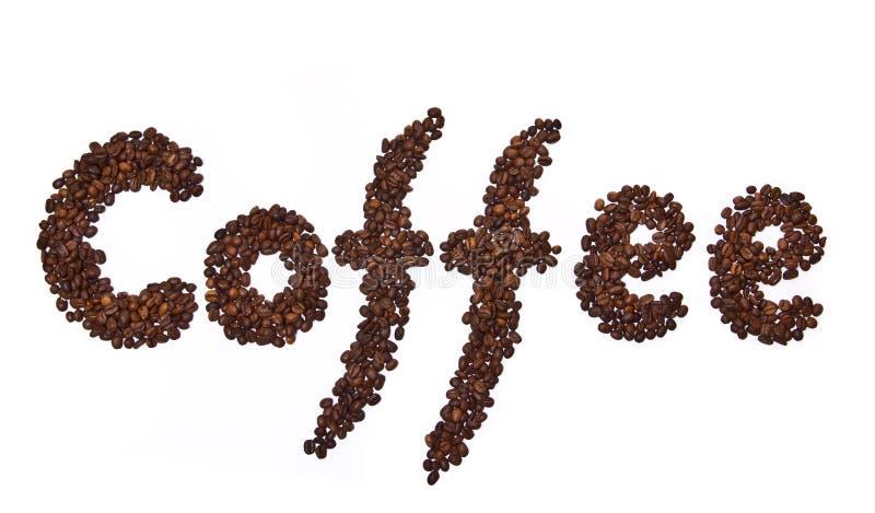 Parola del caffè scritta dai chicchi di caffè immagini stock