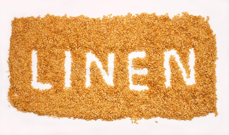 Parola del lino fatta dal seme di lino su fondo bianco Lino dorato s immagine stock
