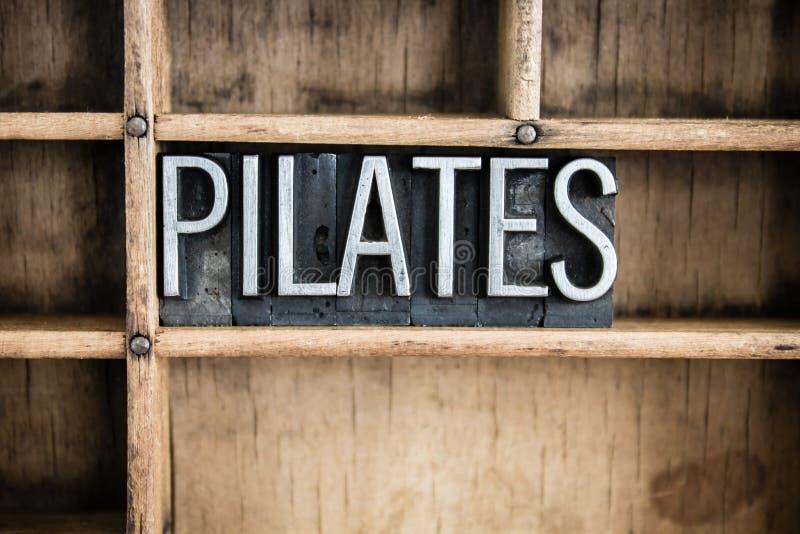 Parola dello scritto tipografico del metallo di concetto di Pilates in cassetto fotografie stock libere da diritti