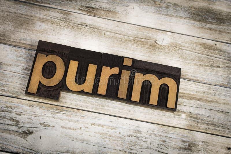 Parola dello scritto tipografico di Purim su fondo di legno fotografia stock libera da diritti