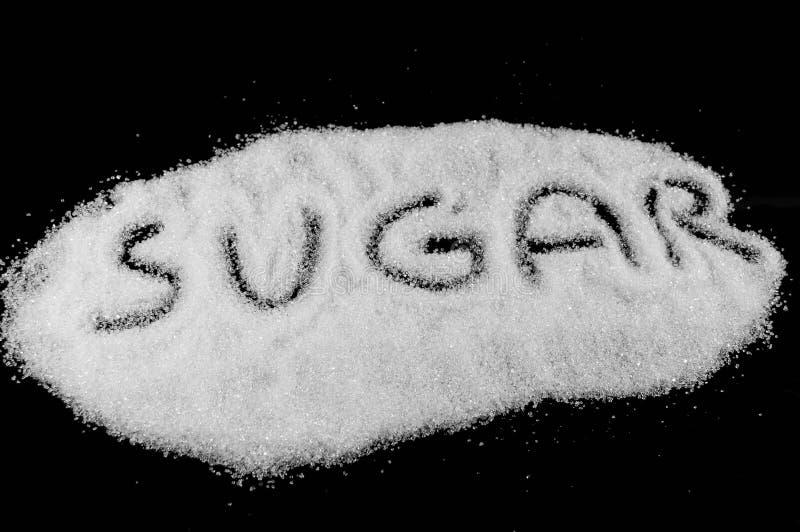 Parola dello zucchero scritta su zucchero bianco fotografia stock libera da diritti