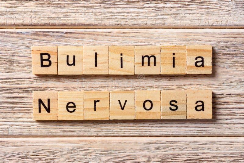 Parola di bulimia nervosa scritta sul blocco di legno Testo di bulimia nervosa immagini stock libere da diritti