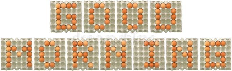 Parola di BUONGIORNO dalle uova in vassoio fotografia stock