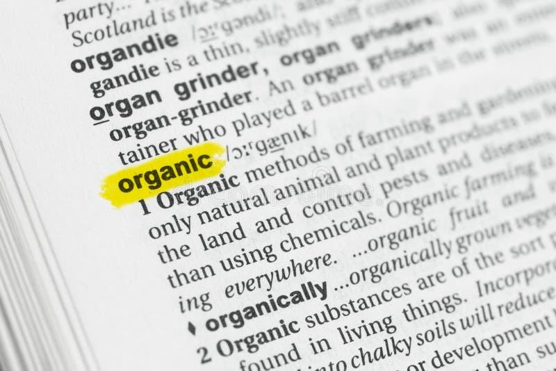 Parola inglese evidenziata & x22; organic& x22; e la sua definizione al dizionario fotografia stock libera da diritti