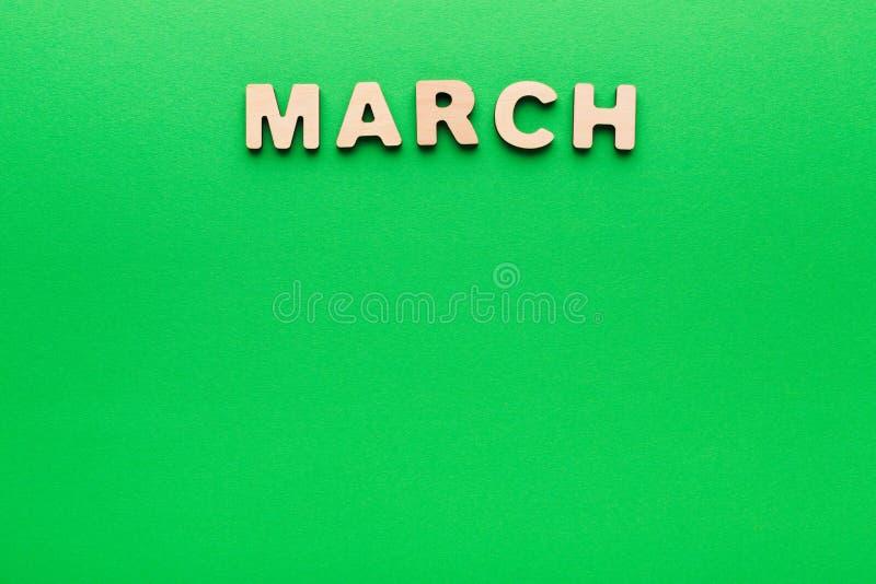 Parola marzo su fondo verde fotografie stock libere da diritti